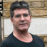 SIMON COWELL IS PROUD TO BE A DAD