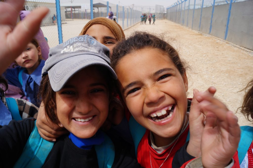 As I recall the caption for the image said something like: Between the fences. Za'atari refugee camp school girls. (Photo by Kirsten Koza)
