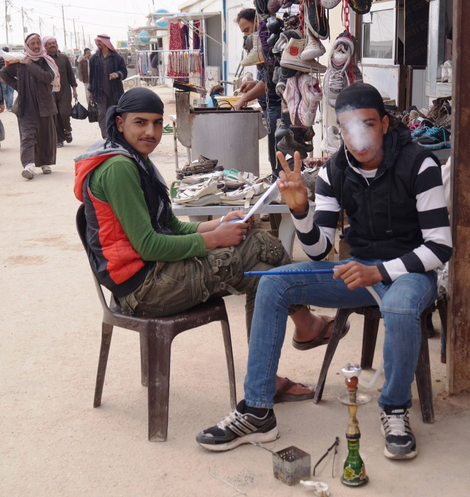 Sadly not a planned gap year for the Syrian youth of Al Za'atari refugee camp. Hopes of post-secondary education are being extinguished as time passes, but there's lots of time to smoke a hookah along the main market street dubbed Champs-Élysées. (Photo by Kirsten Koza)