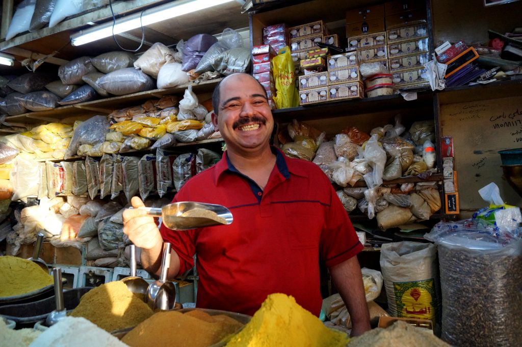 Jordan doesn't have oil, but it has spice and welcoming smiles. (Photo of Fadel Al-Baba, spice merchant in Aqaba, by Kirsten Koza)