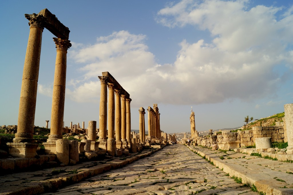 At Jordanian tourist sites, such as the Roman ruins of Jerash, Syrian refugees hide behind pillars and in theaters with their wares that they desperately hope to sell to tourists. (Photo by Kirsten Koza)