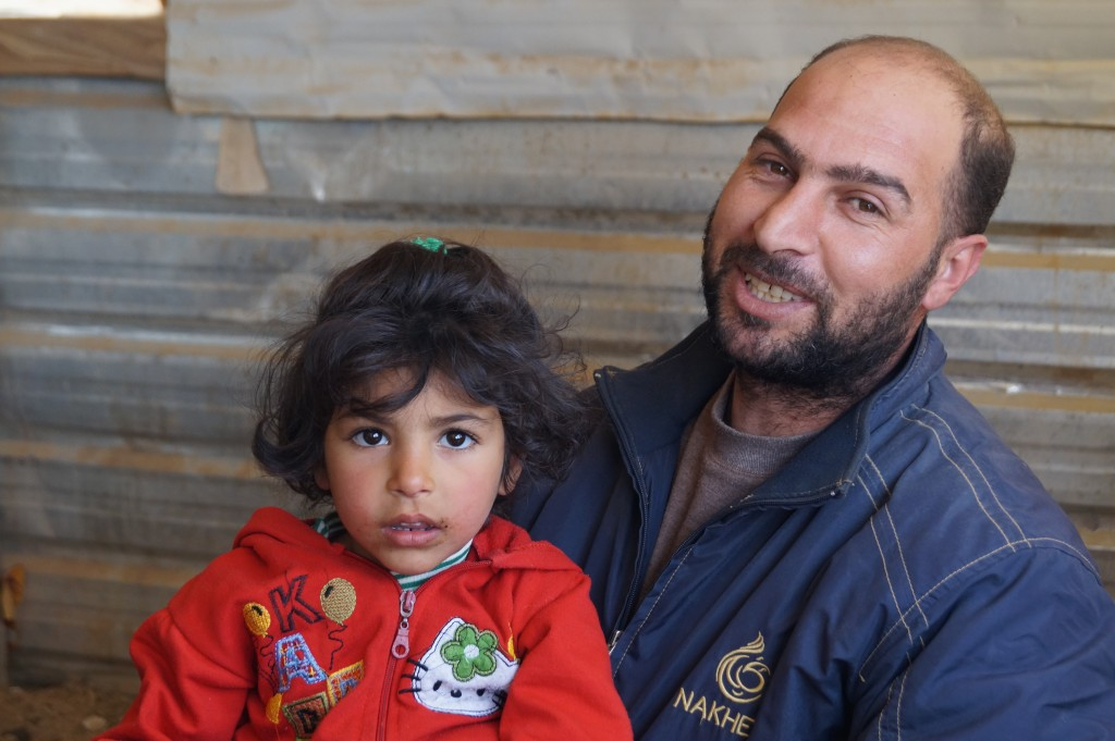 Manal Salem al Ahmad's daughter and husband. The fled Syria a year and a half ago and are separated from family members who didn't make it into Jordan. (photo by Kirsten Koza)