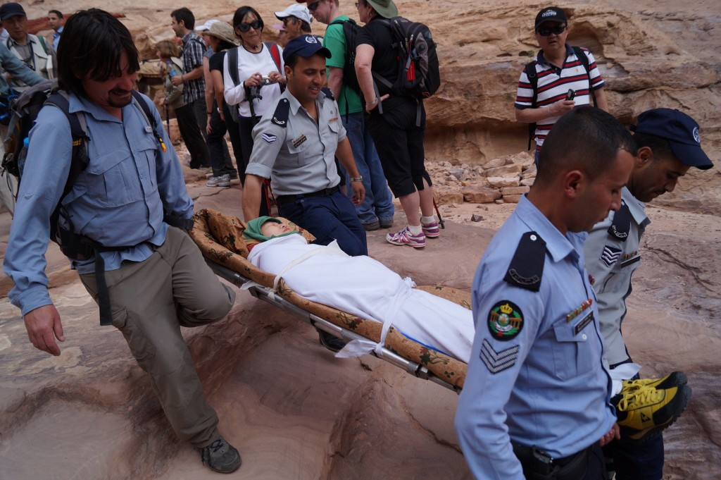 A tourist collapses near the top of the stairs to the monastery at Petra, in Jordan. (photo by Kirsten Koza)