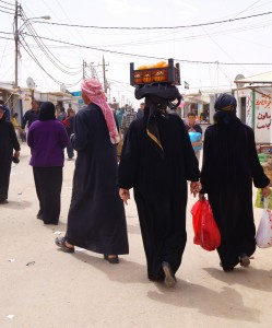 Syrian women in Za'atari wear head coverings, veils, or burqas. (photo by Kirsten Koza)