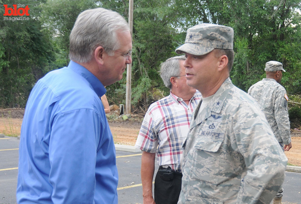 Missouri Gov. Jay Nixon (left) speaks with Brig. Gen. David Newman of the state's Air National Guard during a weather event last year. (Photo: Missouri National Guard/handout)