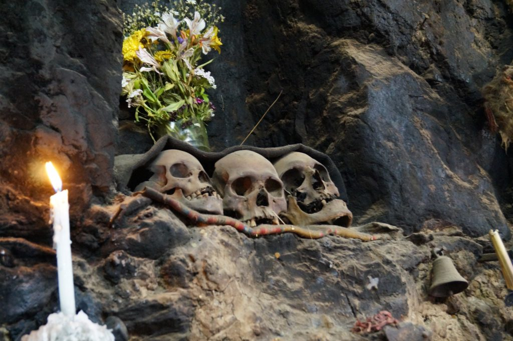Skulls overlook the living room of a house in Ollantaytambo. (photo by Kirsten Koza)