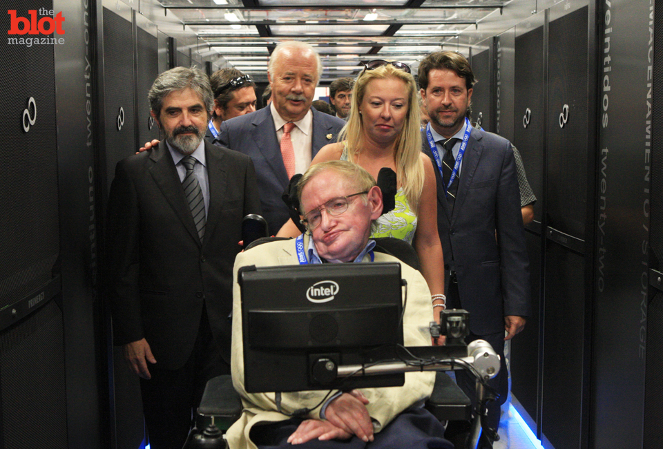 You may know his name, but you likely don't know a thing about the work of Stephen Hawking, seen here visiting a supercomputer in Spain with his staff, so we're here to tell you why he's the Belle of the Brainiac Ball. (© Splash News/Corbis)