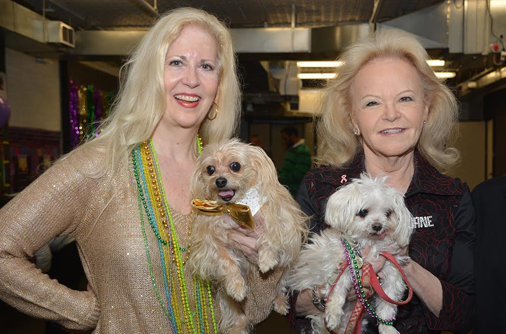 Rockette Leslie Riddle with her dog Puccini and Playboy Bunny Jane Pontarelli holding her Lulu.