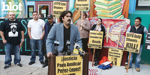 A lawsuit has been filed against the San Francisco Police Department over the shooting death of Guatemalan immigrant Amilcar Perez-Lopez in February. In above photo, Frank Lara of the ANSWER Coalition speaks outside a town hall meeting about Perez-Lopez's death.  (sfexaminer.com photo)