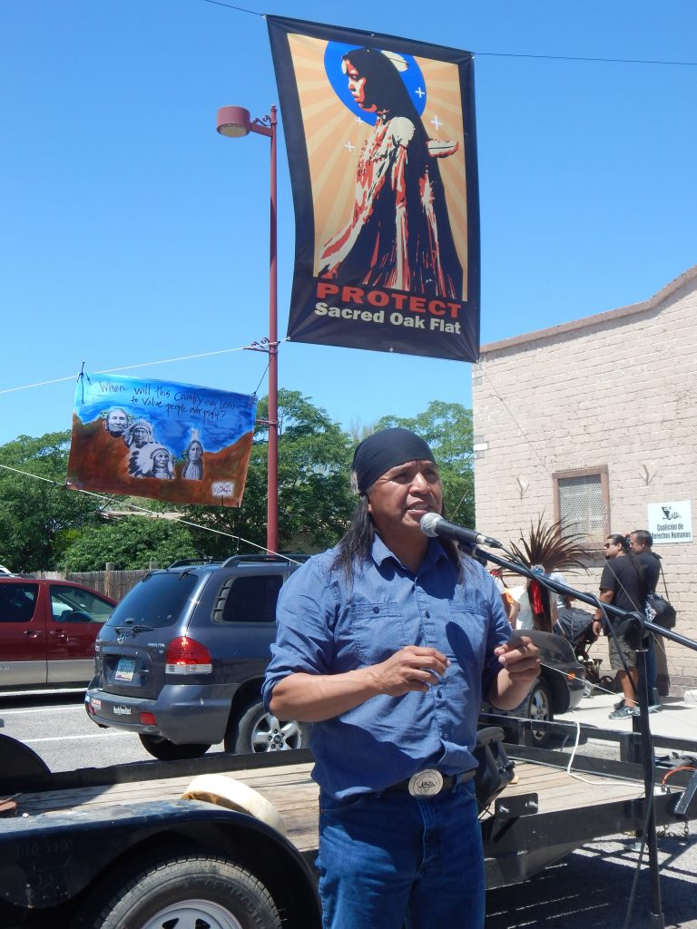 San Carlos Apache Vice Chairman Tao Etpison spoke to those gathered at the Oak Flat Street Fair on April 19. (Photo by Sandra Rambler)
