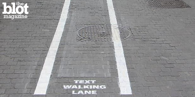 Jeff Myhre makes a pitch for pedestrian texting lanes so those who are so busy and important they have to text-walk can get the hell out of everyone's way. (news.com.au photo)