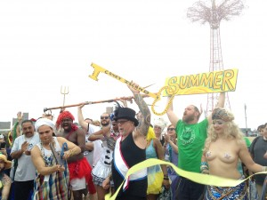 Unofficial opening of Coney Island beach by Mermaid Parade founder Dick Zigun (in top hat)