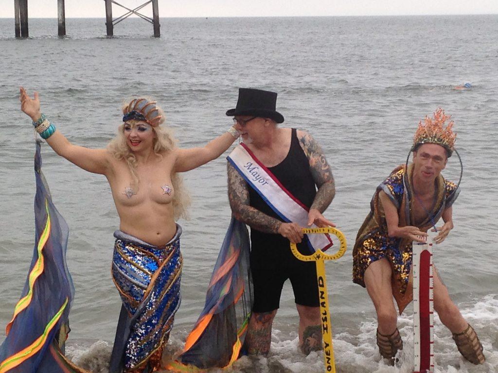 Coney Island parade founder Dick Zigun (in top hat) opening the beach