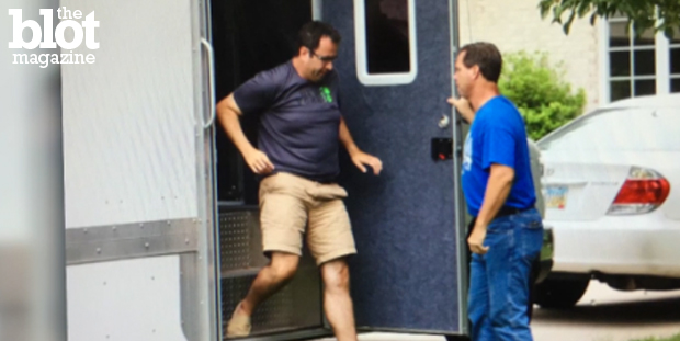 Subway spokesperson Jared Fogle's home was raided Tuesday two months after the former director of his charity was arrested on child porn charges. Fogle is seen above at his home during Tuesday's investigation. (Screen capture from usatoday.com)