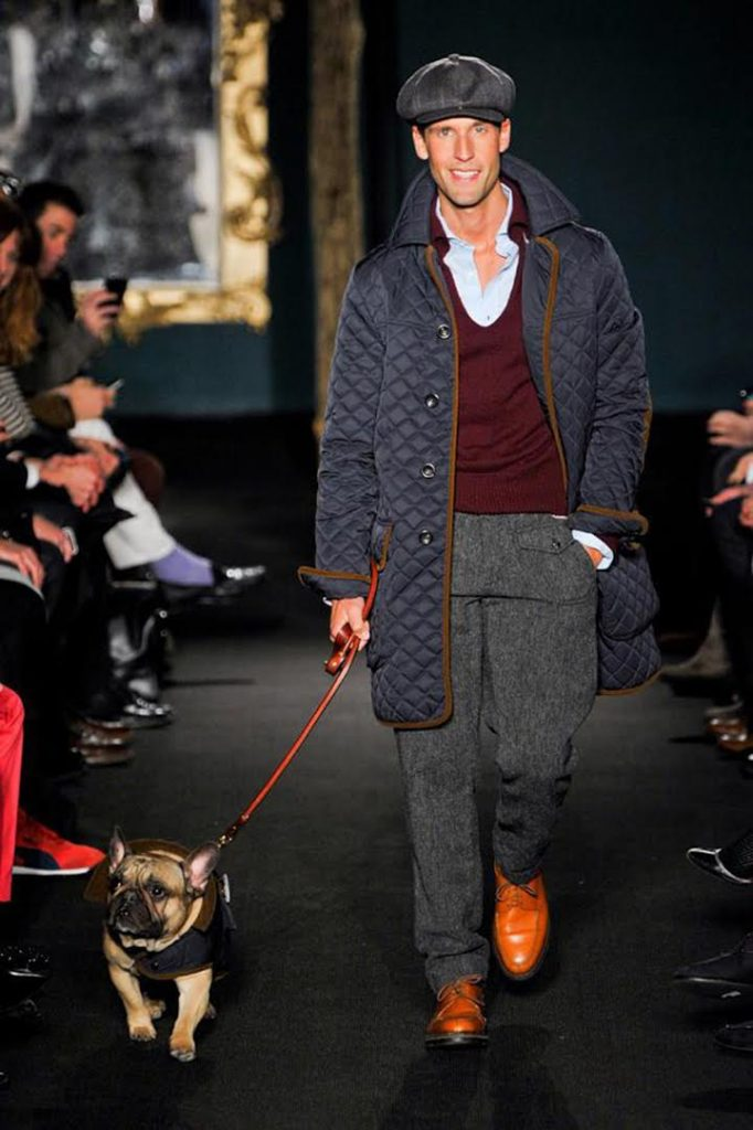 '(UN)Glamorous' filmmaker Pedro Andrade and his dog Mr. Miles walk the runway for Michael Bastian in 2012. (Photo courtesy Pedro Andrade)