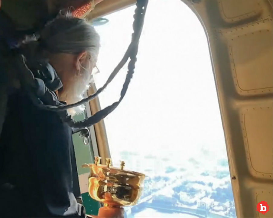 Russian Orthodox Priests Spray City With Holy Water from Plane