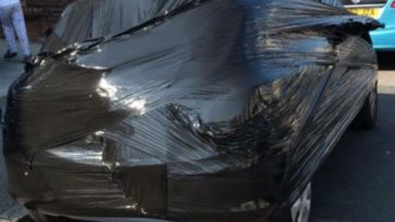 Man Wraps Neighbor's Car in Plastic for Stealing Parking Spot
